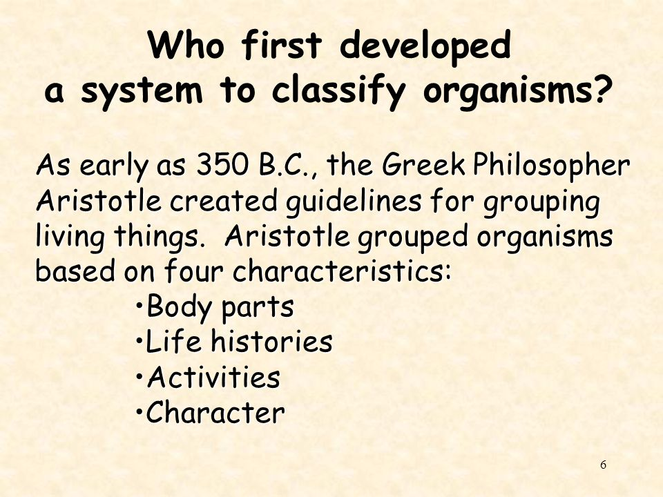 Who first developed a system to classify organisms
