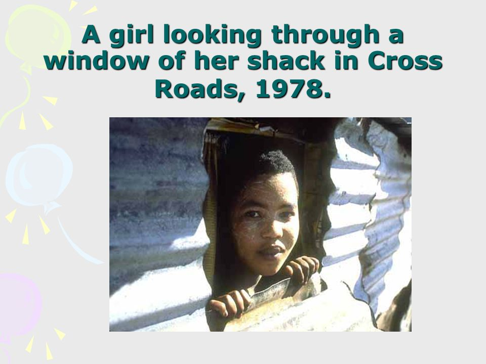 A girl looking through a window of her shack in Cross Roads, 1978.