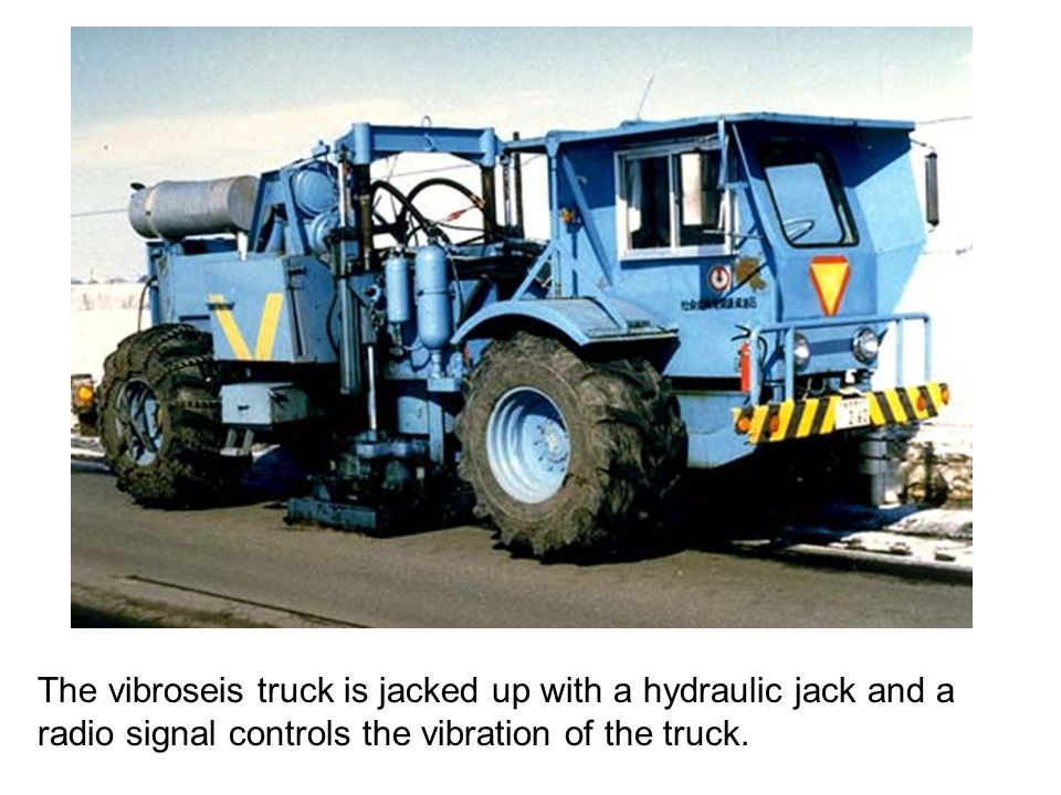 The vibroseis truck is jacked up with a hydraulic jack and a radio signal controls the vibration of the truck.