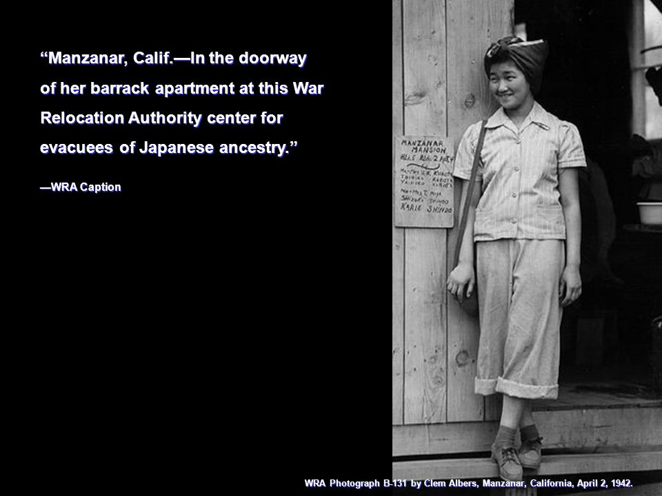 Manzanar, Calif.—In the doorway of her barrack apartment at this War Relocation Authority center for evacuees of Japanese ancestry.