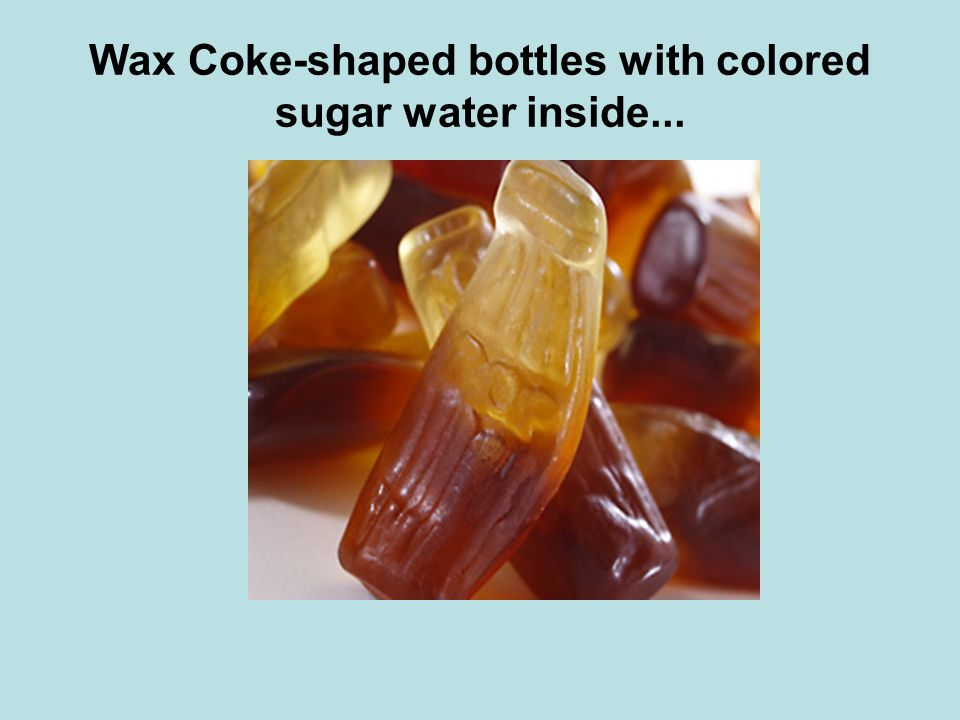 Wax Coke-shaped bottles with colored sugar water inside...