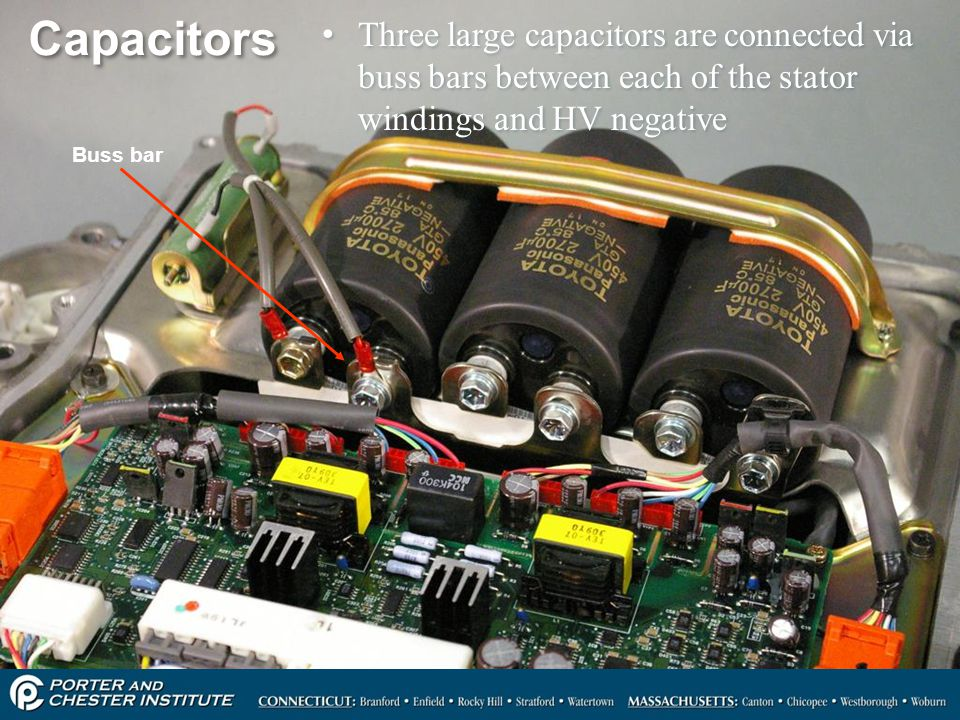 Capacitors Three large capacitors are connected via buss bars between each of the stator windings and HV negative.