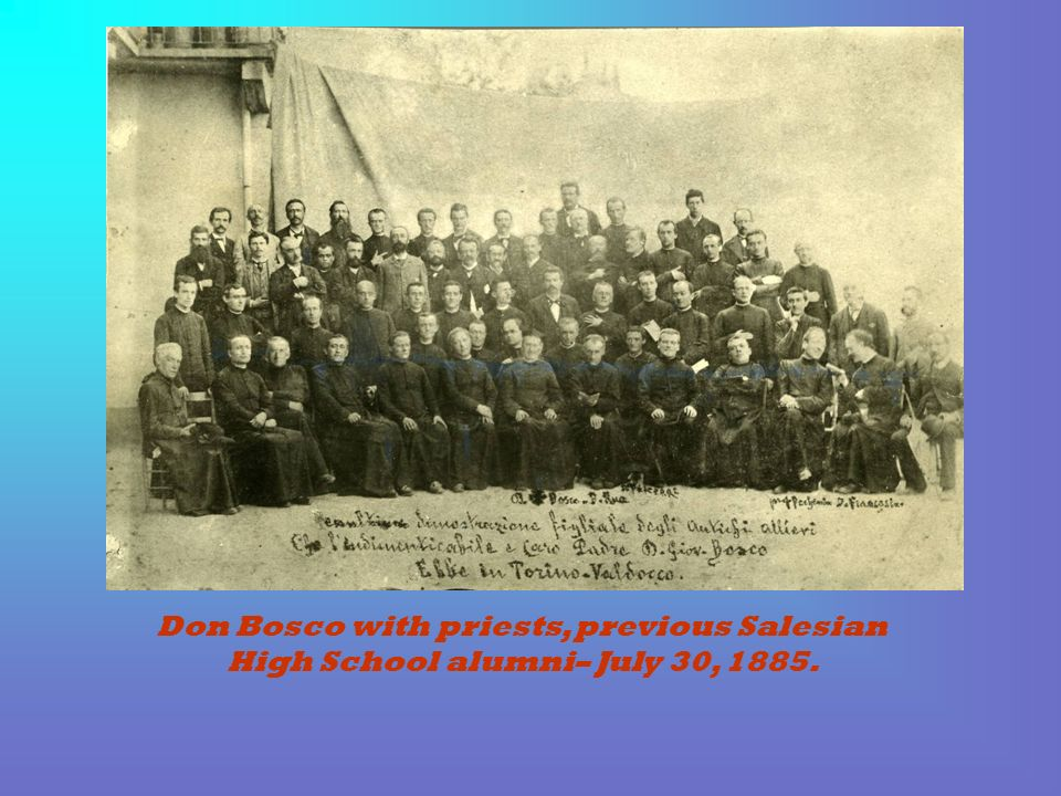 Don Bosco with priests, previous Salesian High School alumni– July 30, 1885.