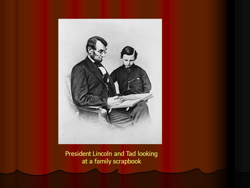 President Lincoln and Tad looking at a family scrapbook