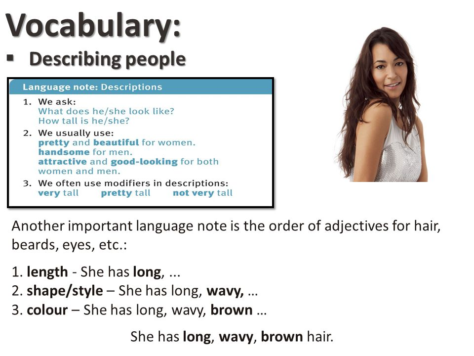 She has long, wavy, brown hair.