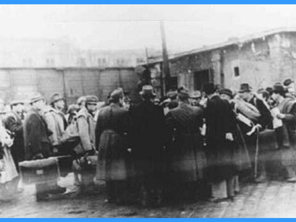 At the Jozsefvarosi train station in Budapest, Raoul Wallenberg (at right, with hands clasped behind his back) rescues Hungarian Jews from deportation by providing them with protective passes.
