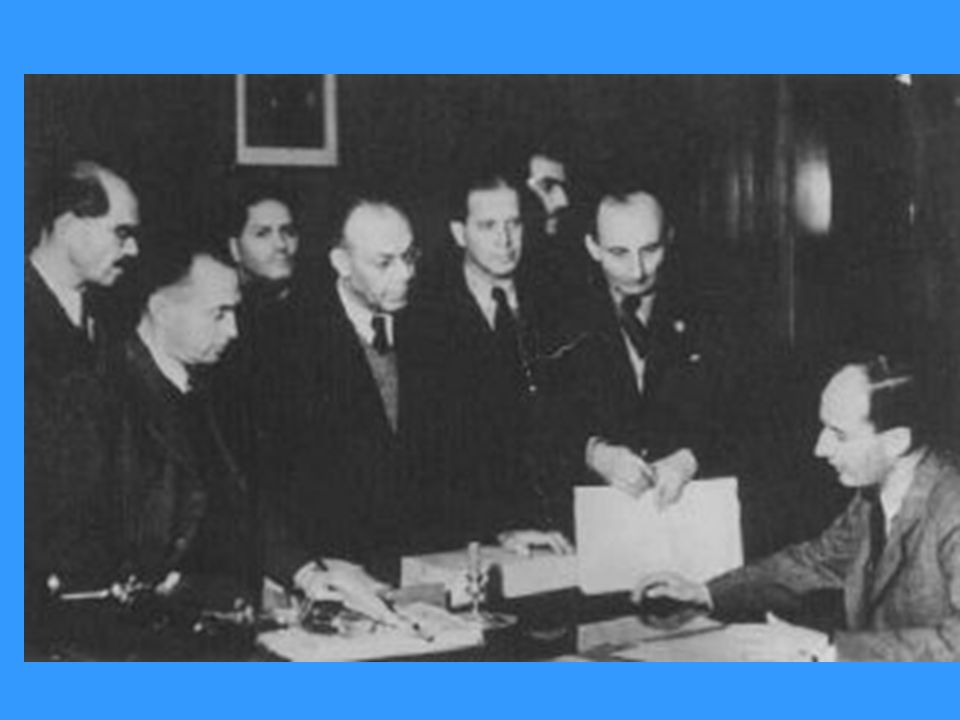 Raoul Wallenberg (seated) at the Swedish legation, with his Hungarian Jewish co-workers.