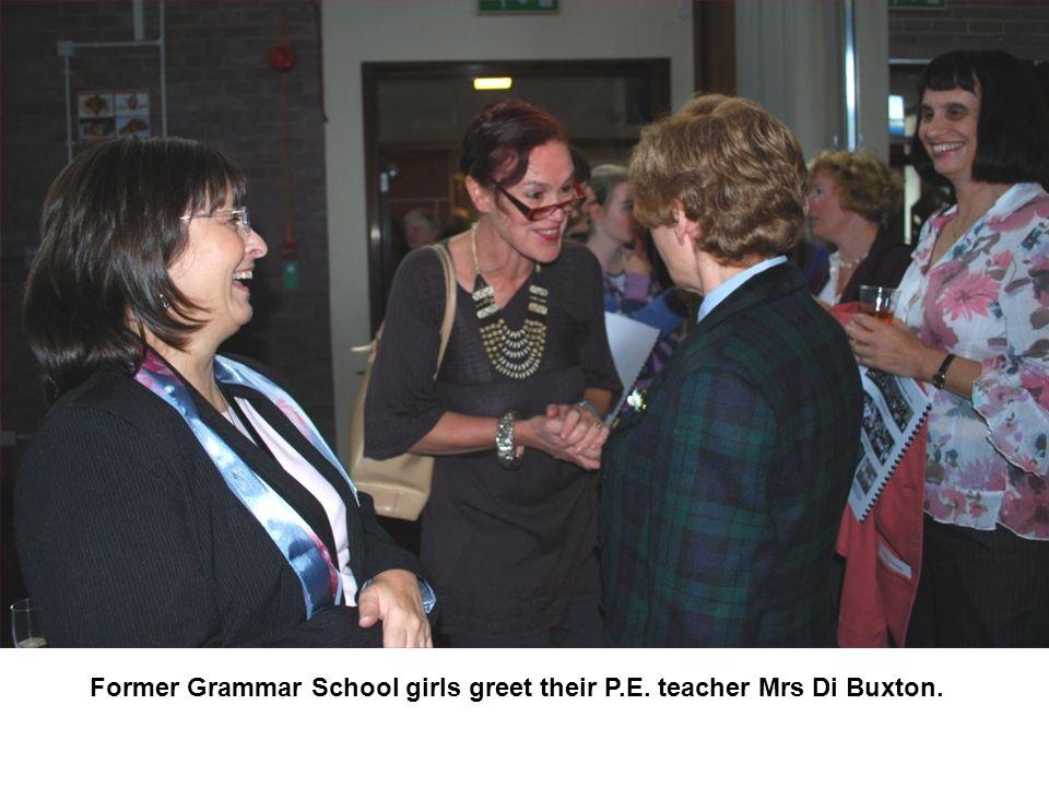 Former Grammar School girls greet their P.E. teacher Mrs Di Buxton.