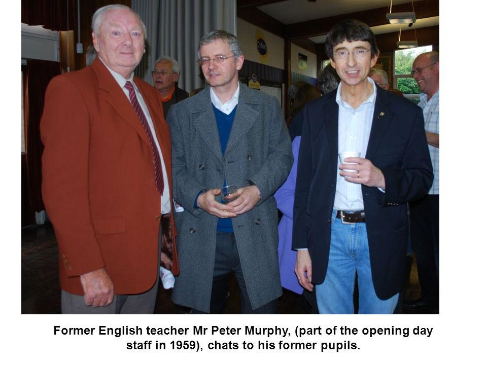Former English teacher Mr Peter Murphy, (part of the opening day staff in 1959), chats to his former pupils.