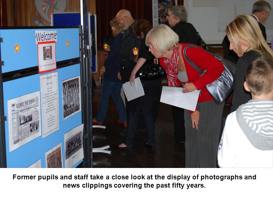 Former pupils and staff take a close look at the display of photographs and news clippings covering the past fifty years.