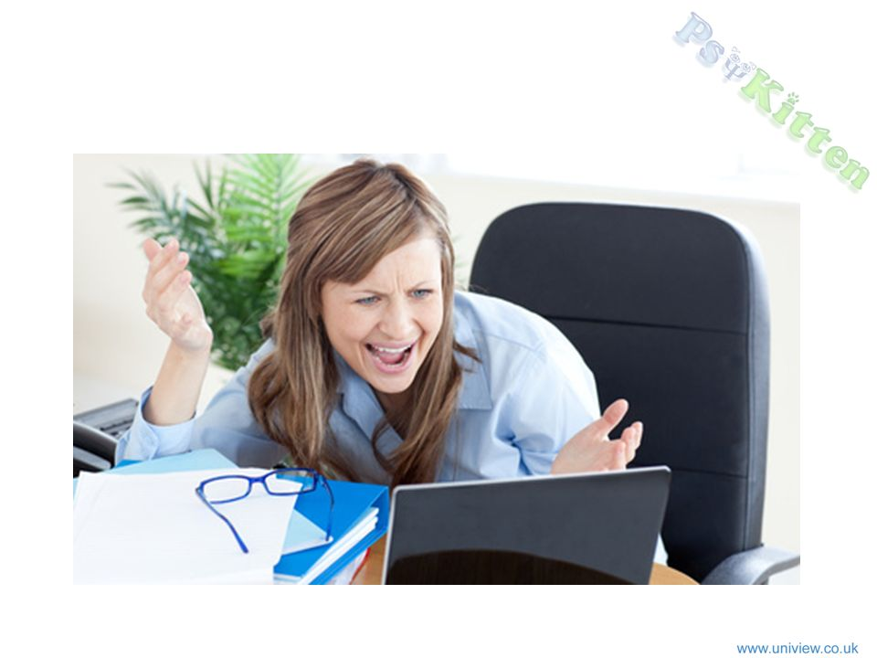 Woman exclaiming at computer