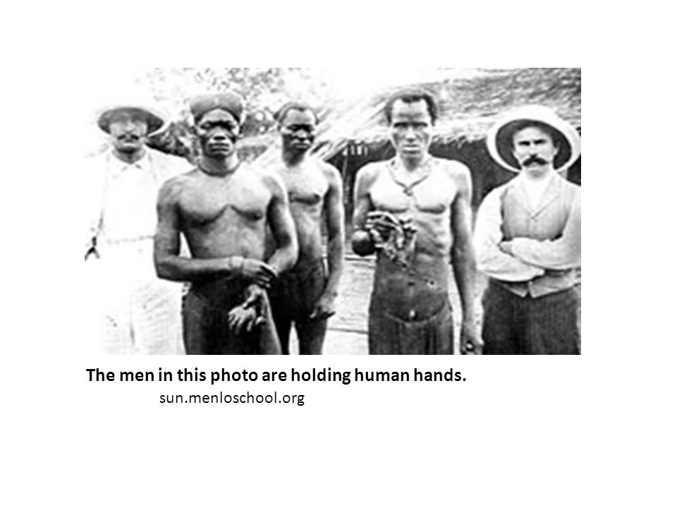 The men in this photo are holding human hands.