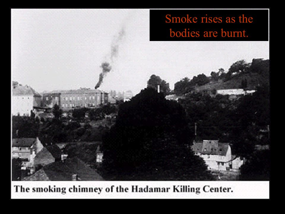 Smoke rises as the bodies are burnt.