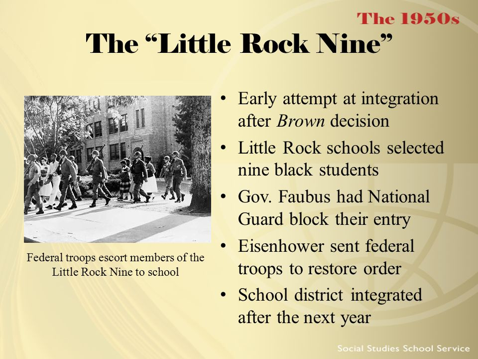 Federal troops escort members of the Little Rock Nine to school