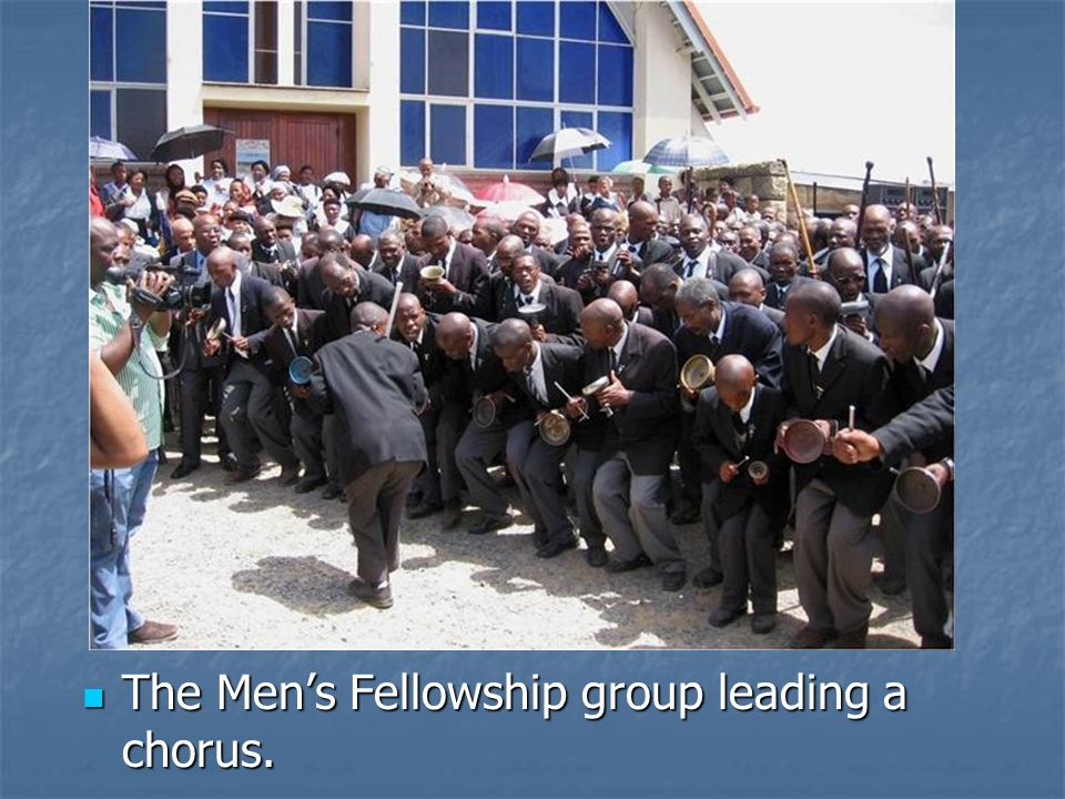 The Men's Fellowship group leading a chorus.