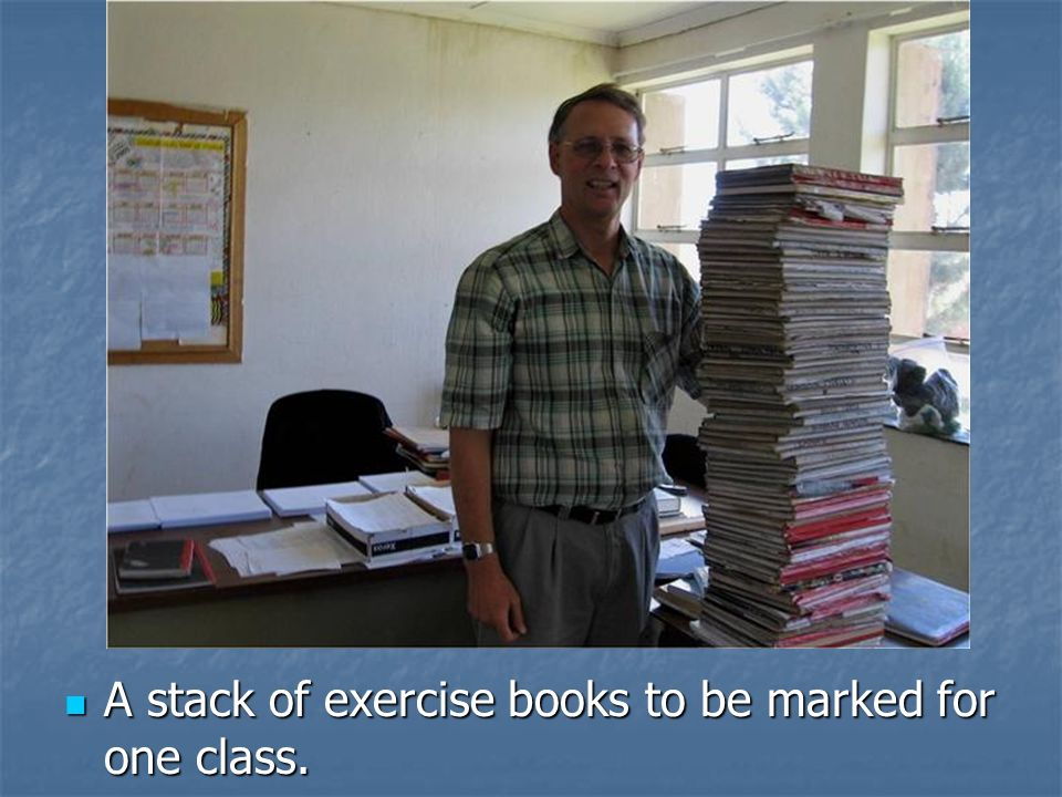A stack of exercise books to be marked for one class.