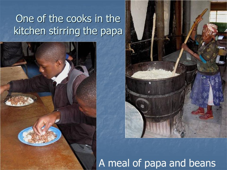 One of the cooks in the kitchen stirring the papa