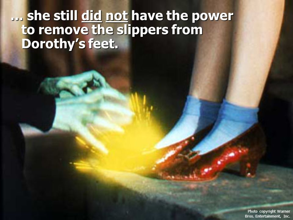… she still did not have the power to remove the slippers from Dorothy's feet.