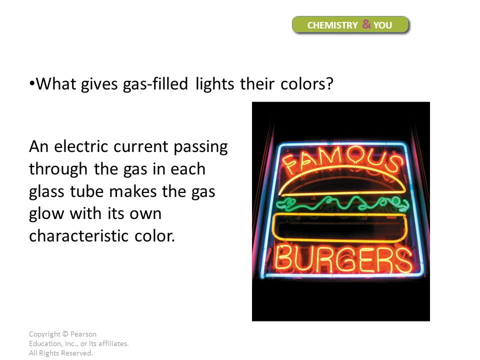 What gives gas-filled lights their colors