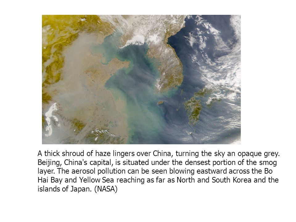 A thick shroud of haze lingers over China, turning the sky an opaque grey.
