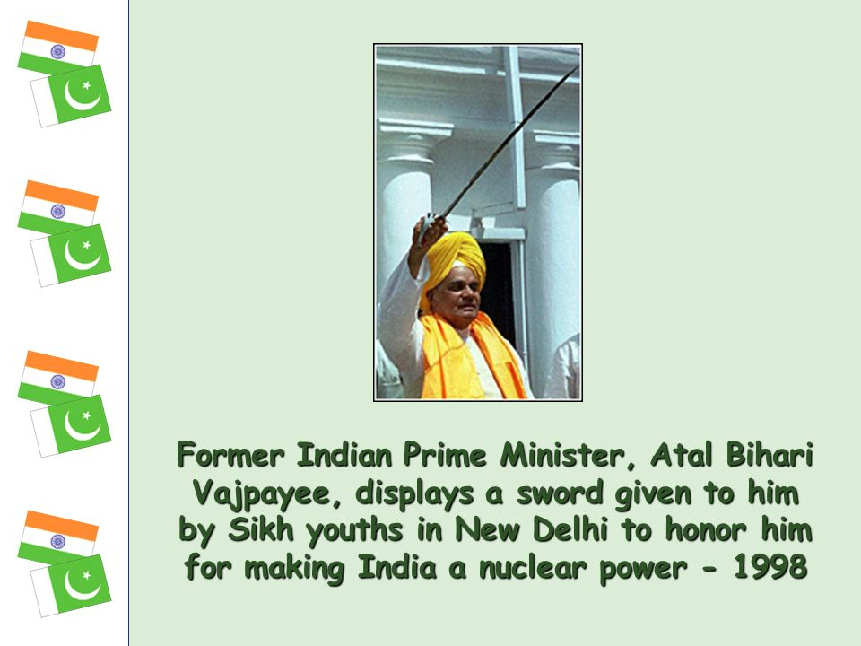 Former Indian Prime Minister, Atal Bihari Vajpayee, displays a sword given to him by Sikh youths in New Delhi to honor him for making India a nuclear power
