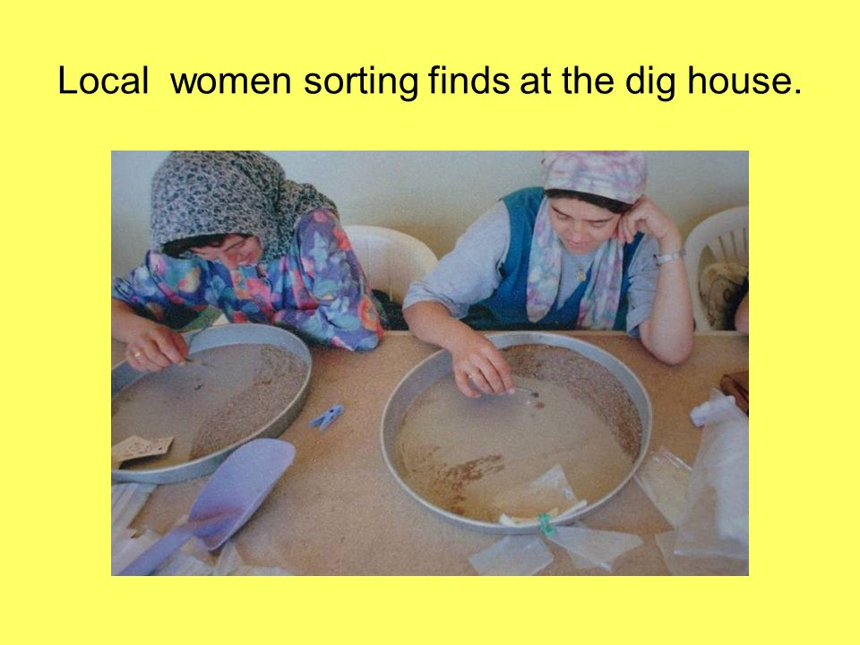 Local women sorting finds at the dig house.