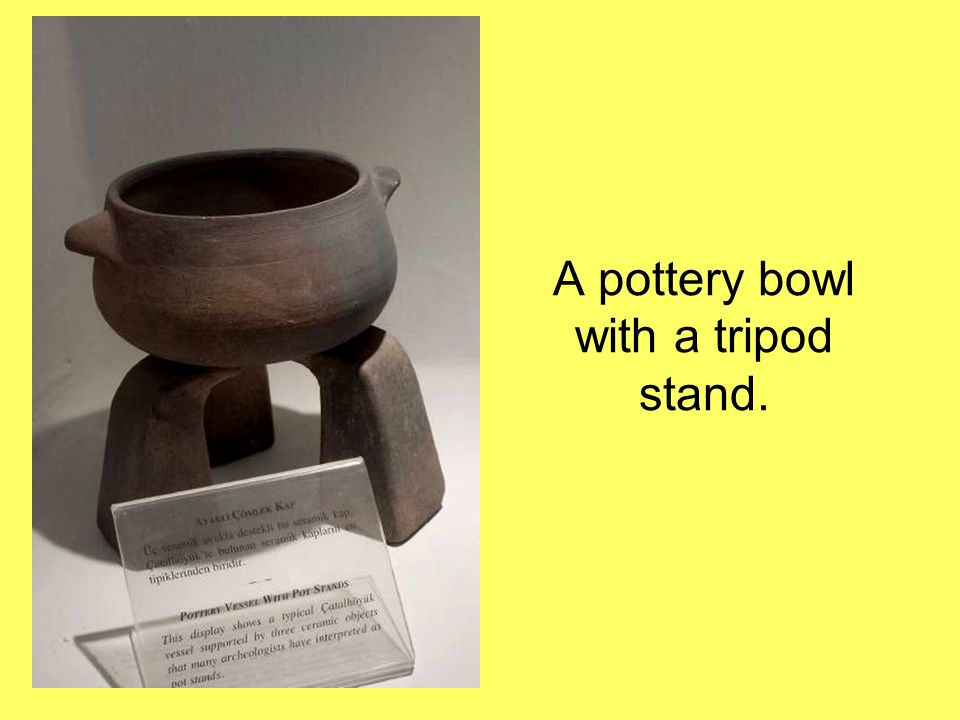 A pottery bowl with a tripod stand.