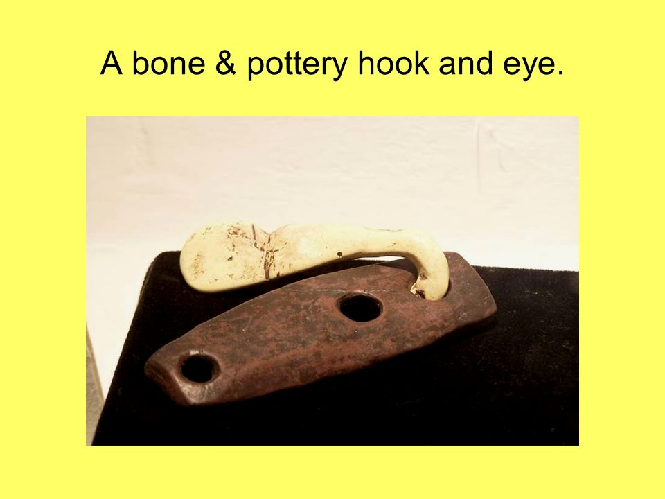 A bone & pottery hook and eye.
