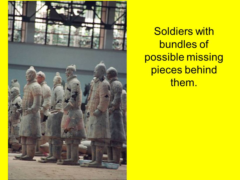 Soldiers with bundles of possible missing pieces behind them.