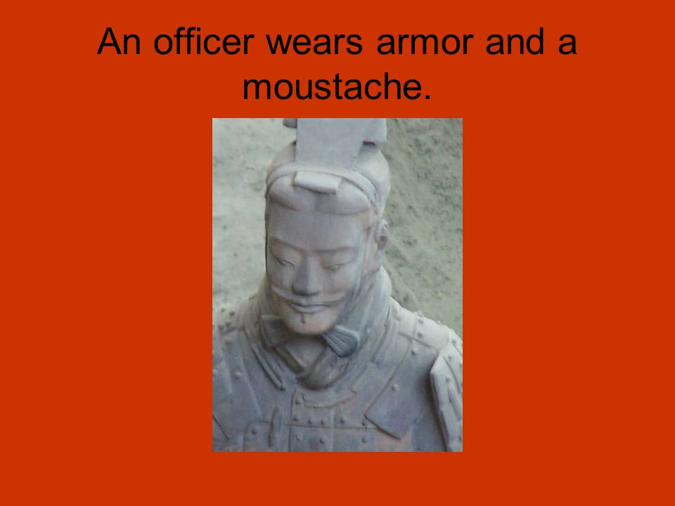An officer wears armor and a moustache.