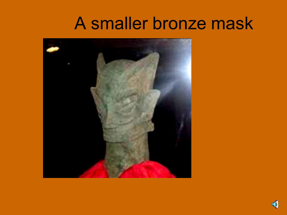 A smaller bronze mask