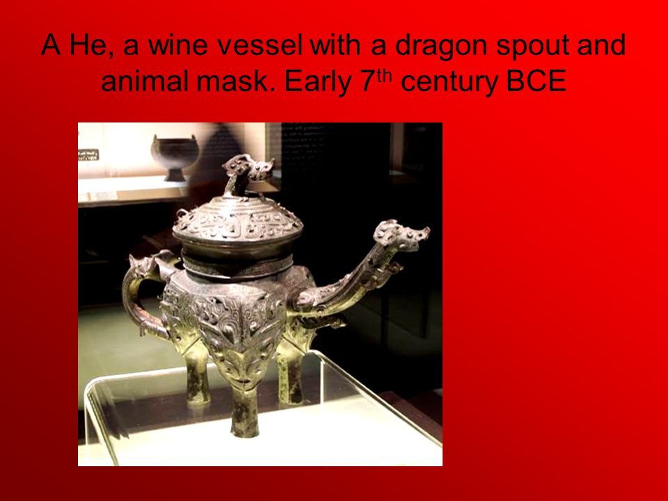 A He, a wine vessel with a dragon spout and animal mask