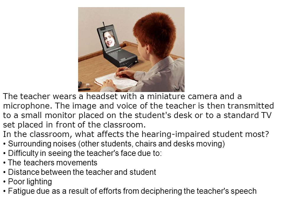 The teacher wears a headset with a miniature camera and a microphone
