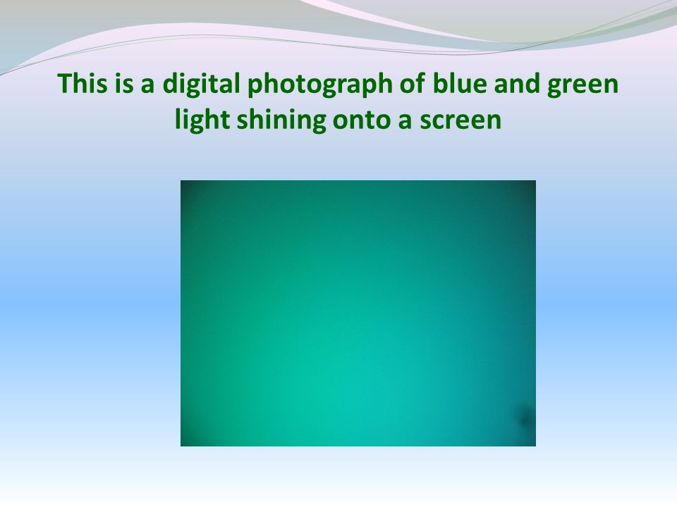 This is a digital photograph of blue and green light shining onto a screen