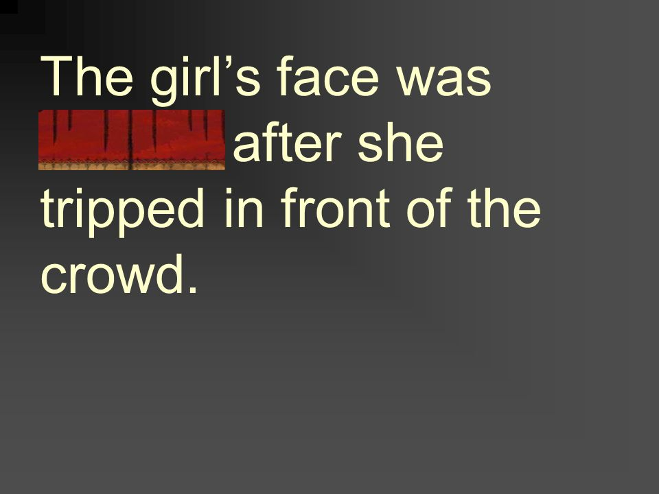 The girl's face was flushed after she tripped in front of the crowd.