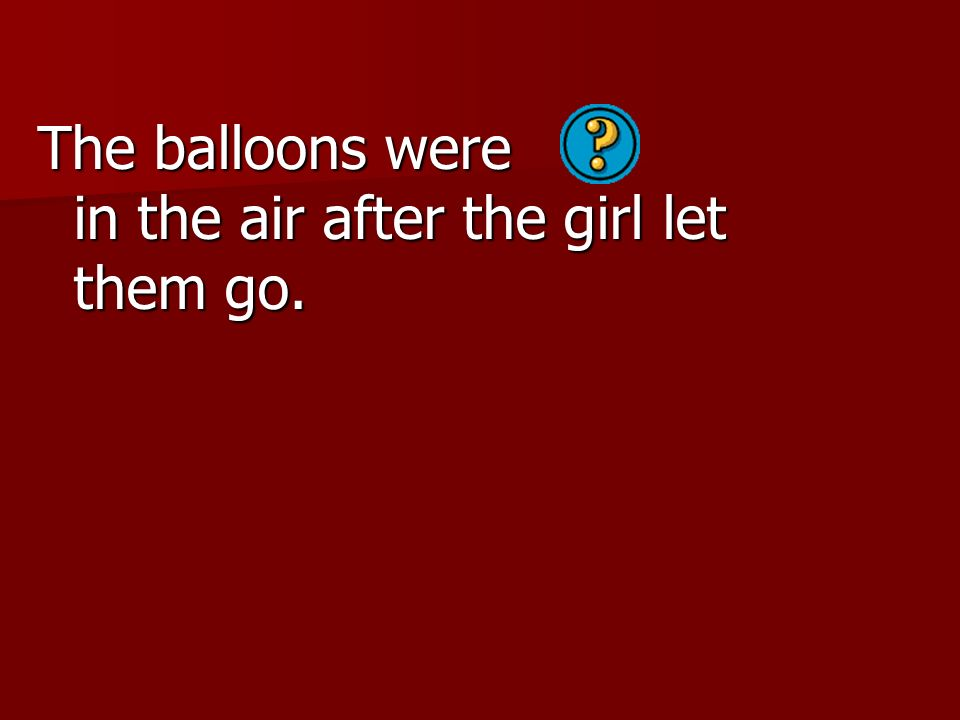 The balloons were in the air after the girl let them go.