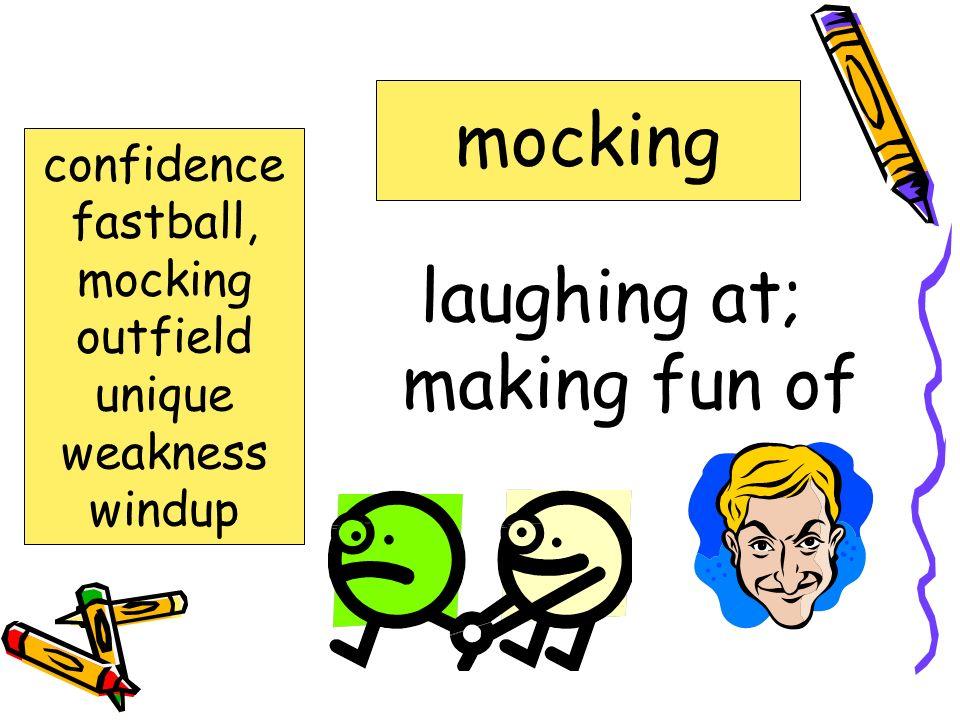 laughing at; making fun of