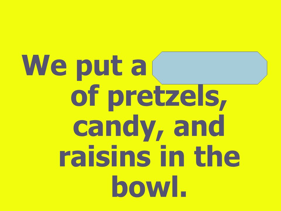 We put a mixture of pretzels, candy, and raisins in the bowl.
