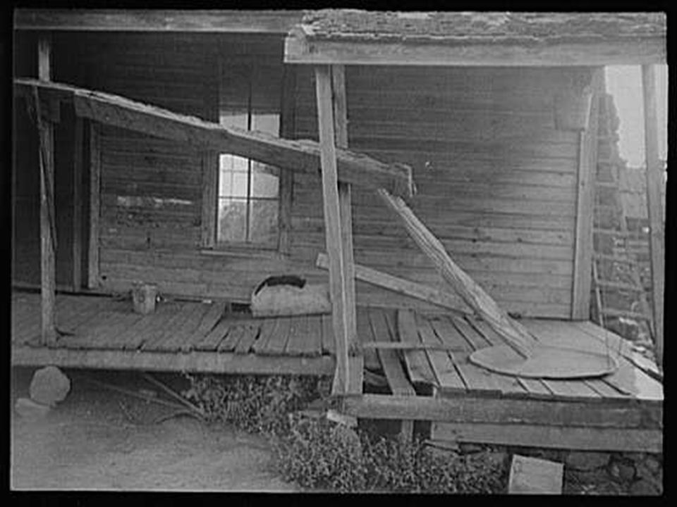 Porch of a sharecropper s cabin. Hale County, Alabama, Summer 1936