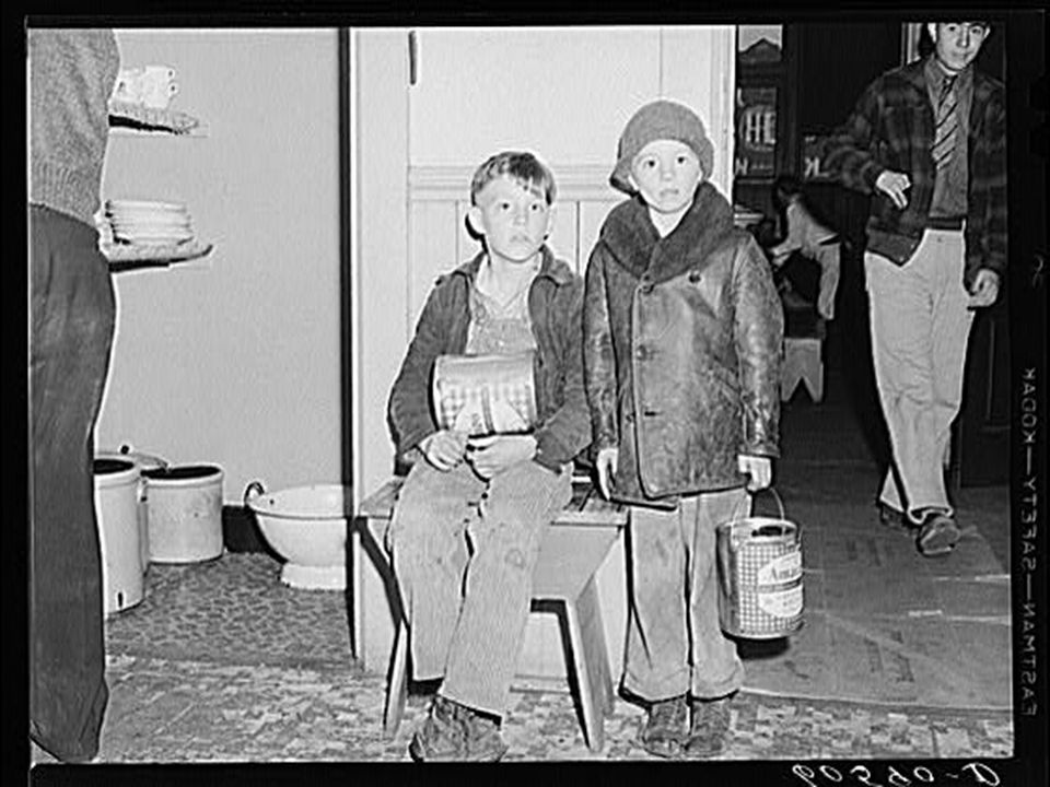 Young boys waiting in kitchen of city mission for soup which is given out nightly.