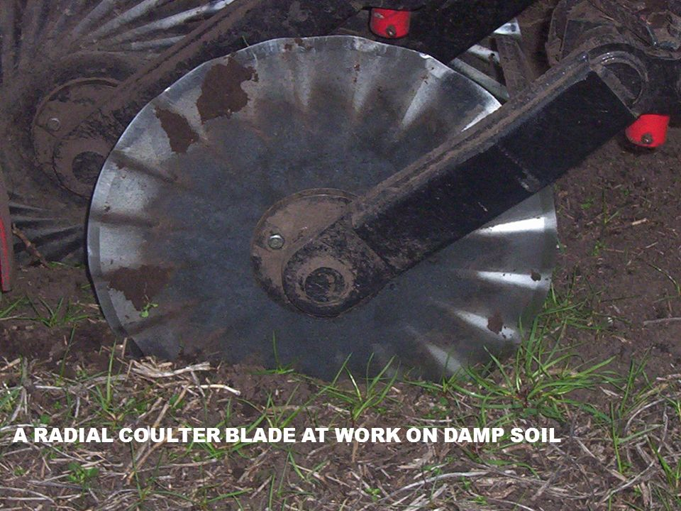 A RADIAL COULTER BLADE AT WORK ON DAMP SOIL