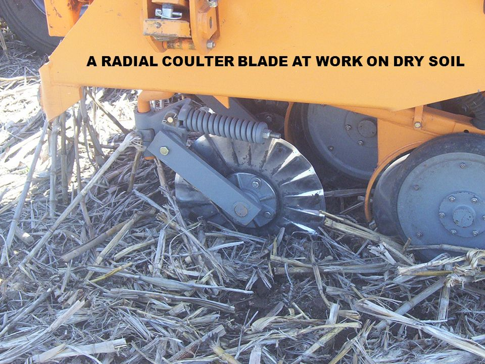 A RADIAL COULTER BLADE AT WORK ON DRY SOIL