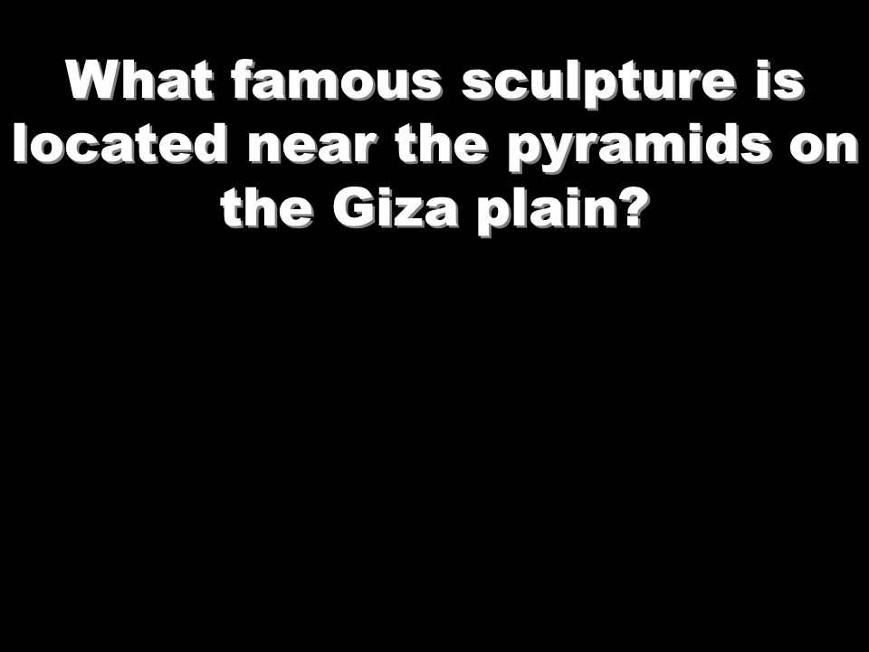 What famous sculpture is located near the pyramids on the Giza plain