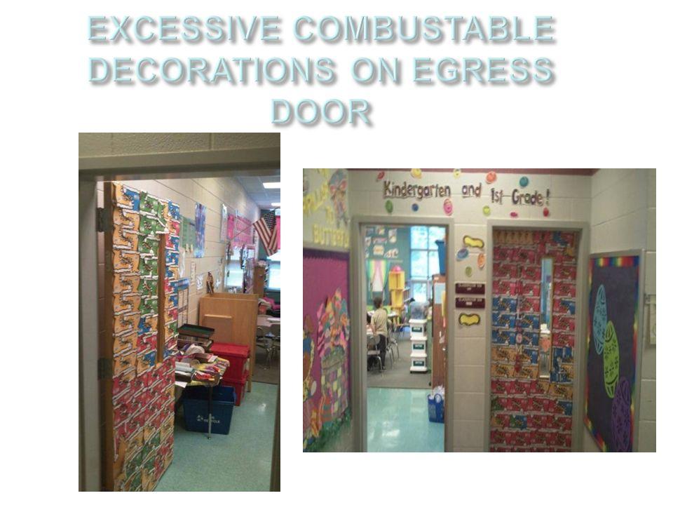 EXCESSIVE COMBUSTABLE DECORATIONS ON EGRESS DOOR