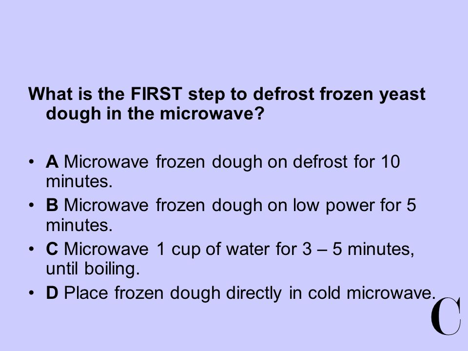 What is the FIRST step to defrost frozen yeast dough in the microwave