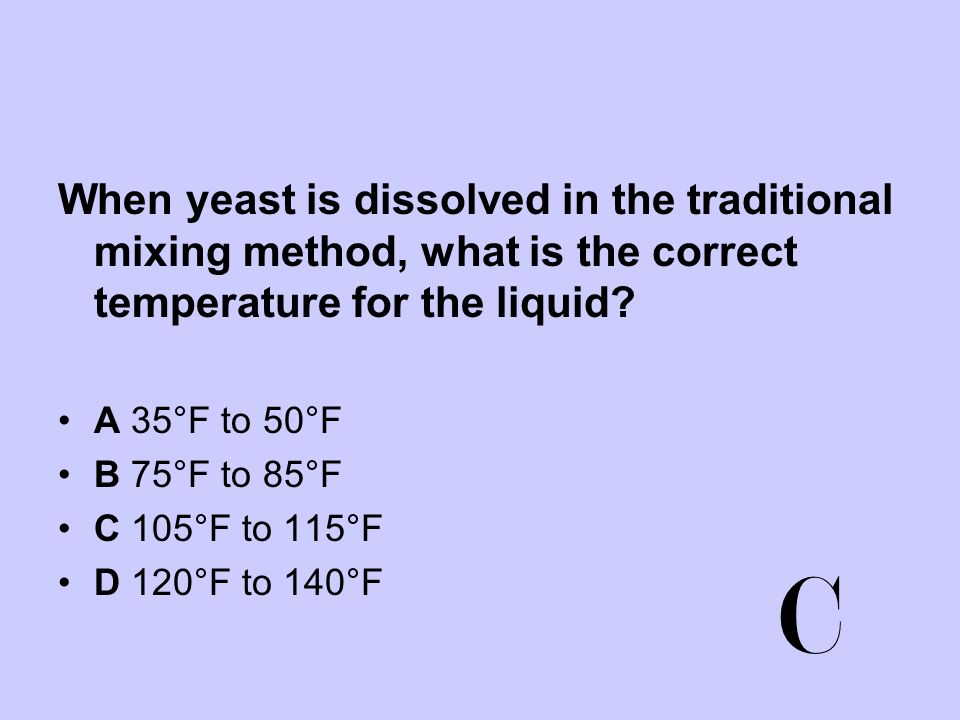 When yeast is dissolved in the traditional mixing method, what is the correct temperature for the liquid