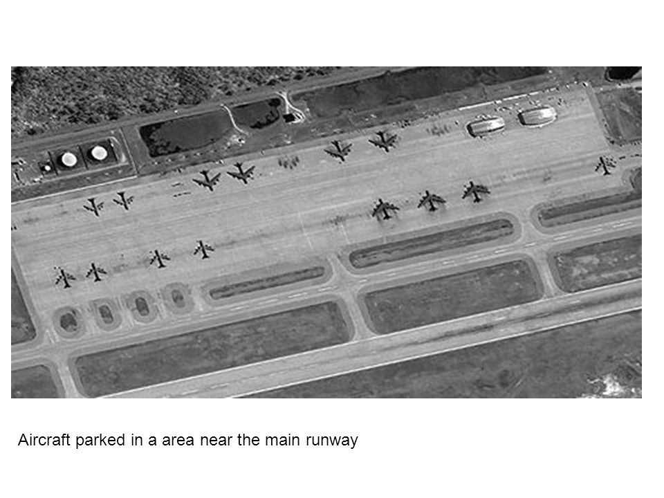 Aircraft parked in a area near the main runway