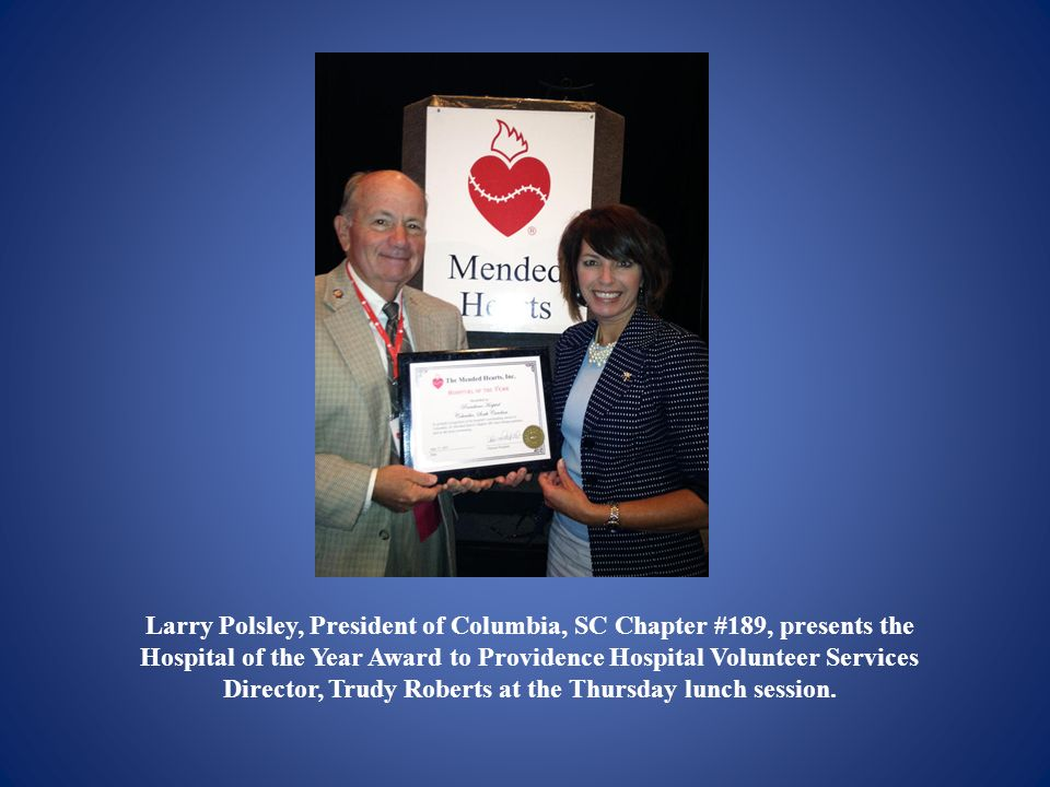 Larry Polsley, President of Columbia, SC Chapter #189, presents the Hospital of the Year Award to Providence Hospital Volunteer Services Director, Trudy Roberts at the Thursday lunch session.