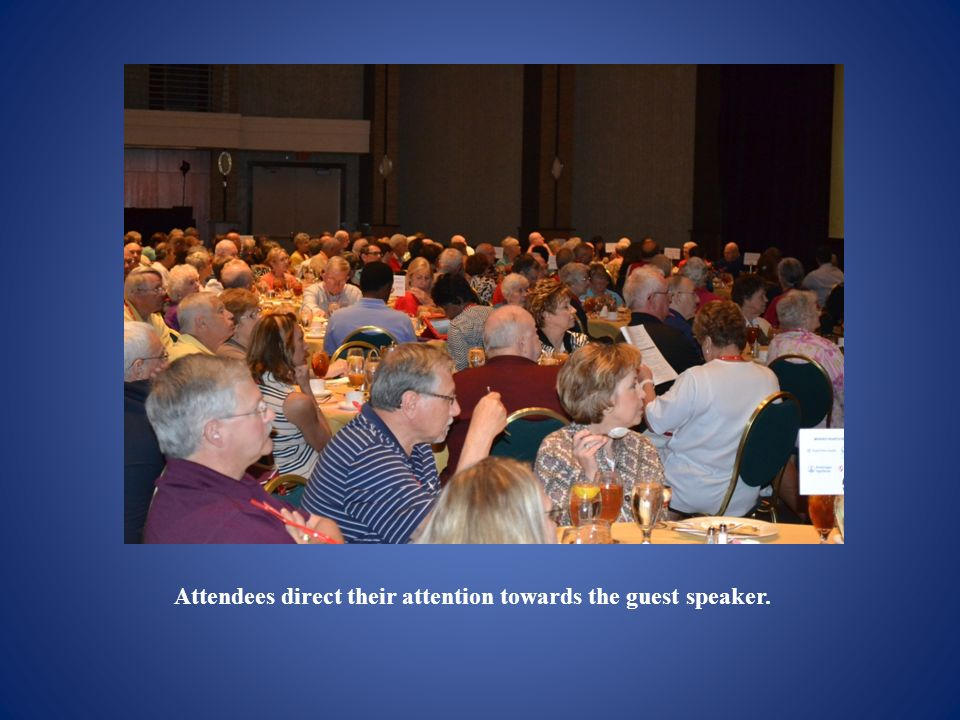 Attendees direct their attention towards the guest speaker.