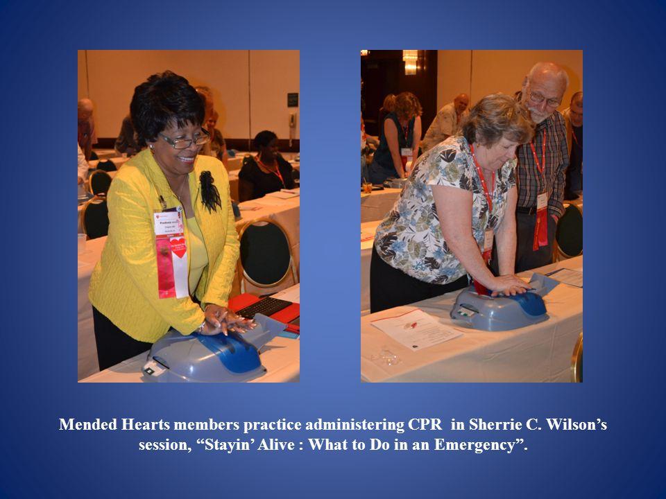 Mended Hearts members practice administering CPR in Sherrie C